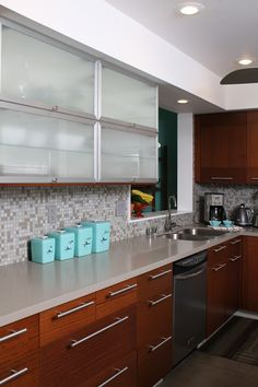 [Kristen and Mike's Mid-Century Oasis  House Tour] Nice redesign of MCM kitchen. I would go for less pronounced cupboard pulls, though (plus, I am SOOO tired of seeing the long chrome pulls).
