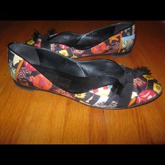 Salvatore Ferragamo Floral & Animal Print Flats Size: 7.5 ( They say size 8, but they run small). Heel height: Approximately 1/4 inch. Printed fabric upper. Grosgrain bow. Leather lining and sole. Made in Italy. Box is NOT included. Please note that there is some wear on soles and toe marks on footbed. Thanks. Salvatore Ferragamo Shoes Flats & Loafers
