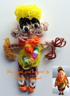 """Rainbow Loom - characters - RUSSELL from the movie """"Up!"""" along with the original picture that I made the design from.  (I still have to make his back-pack, but it took me 3 days to get this just right and I was tired of working on him so I just put his rope and horn in his hands).  Thanks to Cheryl Ann Spinelli of Looming With Cheryl for the ball cap tutorial. More Up! characters coming soon!"""