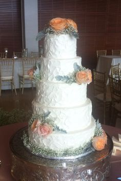 Cakes by Catie Conway AR Textured buttercream wedding cake With fresh flowers