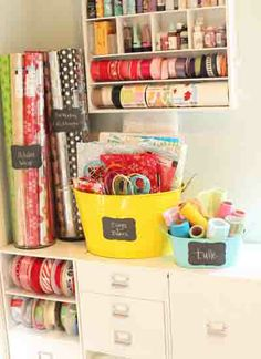 Organized Gift Wrap Corner...**Wrapping Paper is stored in large glass vases w/ chalkboard labels** // **Bags, Boxes & Tissue Paper are stored in a metal Beverage container w/ chalkboard label** // **Tulle is stored in a smaller bin w/ chalkboard label** // at bee in our bonnet: