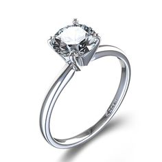 Timeless Four-Prong Round Solitaire Engagement Ring in Platinum