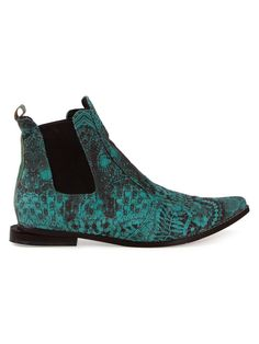 The Coolest Spring Boots in Stores Right Now - FERNANDA YAMAMOTO lace printed ankle boots, $295; at Farfetch