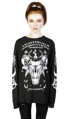 """100% cotton long sleeve tee with front, back and sleeve prints. Model is 5' 6"""" and is wearing size S. Oversized fit. TAG YOUR PURCHASE: #disturbiaclothing IN STOCK & SHIPS WITHIN 24 HOURS"""
