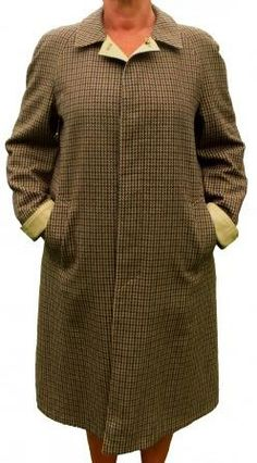 An tan all weather water resistant and a tan woollen tweed reversible a two in one coat with two pockets each side, a back flap, reversible cuff ties, an elegant and warm coat in a straight cut. To Obtain, Travel Outfits, Winter Coats, Warm Coat, Straight Cut, Capsule Wardrobe, Coats For Women, Tweed, Safari
