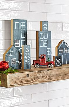 Your mantel is prime Christmas decorating real estate. Develop it creatively with this chalkboard village of Christmas cottages. They're as easy as cut, paint and customize.