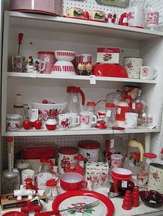 A thoroughly impressive collection of eye-catchingly vibrant red and white vintage kitchenware. #kitchen #vintage #retro #kitsch #red #white #kitchenware #collection #1950s