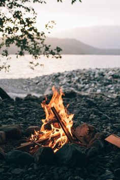 Somewhere away from the maddening crowd. Fire by the edge of the lake.