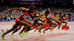 Sprinters explode out of the starting blocks in the in the women's 100-meter final.