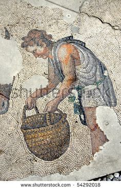 ancient roman mosaic of a man carrying a basket from the remains of the Great Palace at Constantinople - stock photo