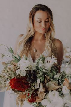 Love this bridal bouquet with its natural textures, flowers and hints of bold color in the neutral palette.  Decor by Kadou.  Stationery by Fleur Design Studio Venue: The Styling Shed Hiring: Grand Room Design Makeup & Hair: Clarita Smit Makeup & Lashes Dress: Janita Toerien