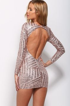 Amazing sequined mini dress. High rounded neckline with button at back. Longsleeve. Detailing bronze sequins contrasted with nude mesh. Sequins run in angular lines along body. Sexy round cut out back. Small visible back zip. Lined. Polyester.