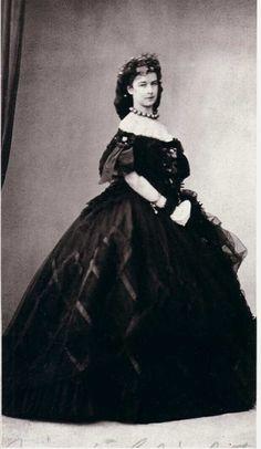 Elisabeth of Austria in a dark colored evening dress, 1860's.