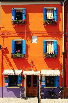 Orange house in *Burano, an island in the Venetian lagoon, Veneto, Italy. - [Photo by josep mª nolla] 120814 Colourful Buildings, Colorful Houses, Trieste, Happy Colors, My Favorite Color, House Colors, Color Inspiration, Travel Inspiration, Orange Color