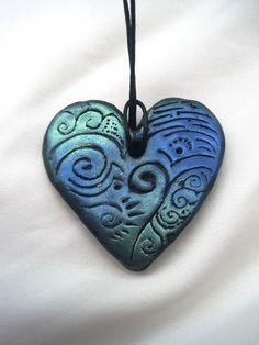 Polymer Clay Heart Pendant by vixensnose.deviantart.com