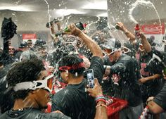 Cleveland Indians team celebrate with champagne in the locker room after they beat the Detroit Tigers  7-4 at Comerica Park in Detroit, Michigan on September 26, 2016.  (Chuck Crow/The Plain Dealer)
