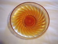 Marigold Carnival glass Dish with Swirled Rays