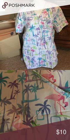 Scrub top Ladies 2 pocket scrub top. Flamingo and palm tree print. Tag removed due to irritation. Barely worn. Tops