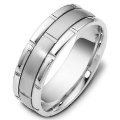 My fiancé wears a similar wedding band that I gave him. White metals: platinum, silver, white gold etc. This is the look for men's wedding rings. Biddy Craft/Platinum Men's Wedding Ring