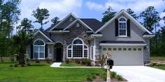 Love the gray stucco with stone