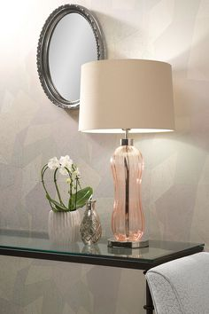 Mae Rose Gold Table Lamp | This Mid Century inspired blown glass shape with optic decoration and finished with beautiful metal detailing will work well in any interior style. The Mae range is available in three colours and clear.