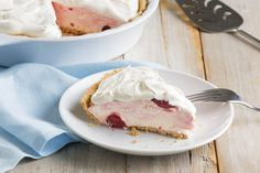 Cherry pie filling swirled into an airy cream cheese mixture is frozen in a graham cracker crust for a simply delicious no-bake dessert.