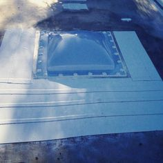 My new skylight!  So much brighter lighter (100 lbs?) sleeker than the old AC unit and hopefully more waterproof too!? The taped area is Eternabond to seal up the hundreds of tiny corrosion holes I discovered under that old AC. That was definitely leak central!  This rainy weekend should put all my roof repairs to the test... fingers crossed!! #goaheadandrain #makemyday