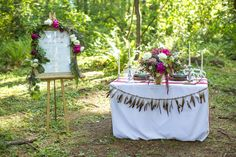 Hunger games wedding inspiration!   Photo: Stevi Sayler Photography | Coordination & styling: Event Crush | Floral Design: Good Seed Floral | Paper Goods: Little Arrow | Decor Rentals: Stepping Stone Wedding Rentals | Cake: Noisette Pastry Kitchen | Catering: Marche | Attire: Blush Bridal | Wedding Venue: Deep Woods Events