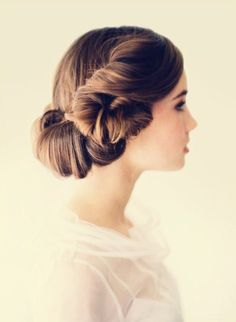 Reminds me of Princess Leia. Would make a wonderful elegant take on her hair. :)