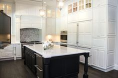 Featured here, our Covington door in maple White and cherry Vintage Charcoal. To our friends in Florida at KabCo Kitchens, thank you for your hard work and dedication to our line of cabinetry! Your creative designs are greatly appreciated.  Learn more about KabCo Kitchens: http://kabcokitchens.com/ Learn more about Showplace Wood Products: http://www.showplacewood.com/