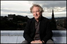 Alan Rickman in Edinburg, not taming the hair