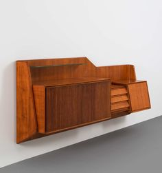 Anonymous; Teak, Mahogany and Glass Wall Cabinet for Palazzi del arte Cantu, 1950s.
