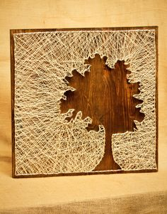 Tree Silhouette String Art. $60.00, via Etsy. This doesn't look so hard!