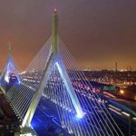 Boston Zakim Bunker Hill Bridge I dislike this bridge, which doesn't match the architecture in Boston despite the use of the Bunker Hill monument motif. (The Bunker Hill Monument can be seen in the distance on the right, above the two green signs. San Francisco, San Diego, Oh The Places You'll Go, Places Ive Been, Places To Visit, Boston Strong, In Boston, Visit Boston, Downtown Boston