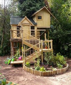 Multi-tiered tree house. Each child has their own section. We love how theres a little garden for them. For more treehouses and playgrounds, click the pic!