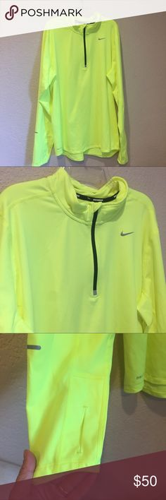 Nike running dri fit neon yellow 3/4 zip top Nike running dri fit neon yellow 3/4 zip top excellent preloved condition with reflective strips size large unisex super soft Nike Tops