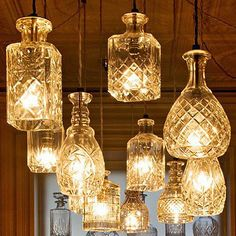 Some type of old school glamour using cut glass bottles as lamp shades. (Also a DIY: Easy way to cut glass bottles ! Decanter Lights, Crystal Decanter, Colored Glass Bottles, Cut Bottles, Liquor Bottles, Decorative Glass Bottles, Patron Bottles, Liquor Bottle Lights, Vodka Bottle
