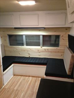 Nikki Dee's Camp trailer remodel. #camptrailer #remodel. Liking the black plaid, wood grain, and white combo.