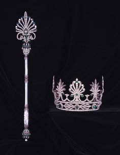 Scepter and crown, carried by Edward Everett Soule as Rex, King of Carnival, 1931. Embellished with colorless and green rhinestones in classical palmetto and honeysuckle design, set in silvertone metal.