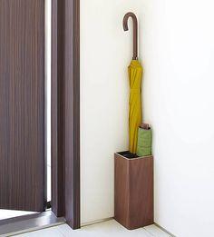 Corner umbrella stand for both short and long umbrellas