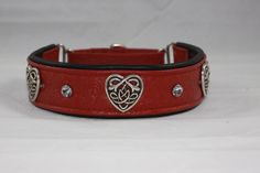 Red western tooled leather with black lining leather. Features three Celtic hearts and four clear crystals. Martingale collar from Collar Addict.