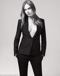 Baring all: The toned-down shoot sees the fashion icon posing in a simple blazer with nothing underneath