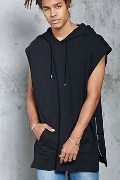 A French terry knit hoodie featuring side zippers at the hem, a kangaroo pocket, sleeveless cut, and a ribbed knit trim.