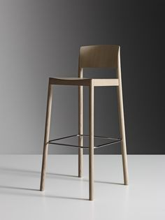 Grace – bar stool by Staffan Holm for Swedese. When tasked with making a bar stool of his chair Grace, Staffan Holm cut the entire chair into pieces, removed them little by little, and then put them back together again – creating a bar stool as elegant as its sister chair.