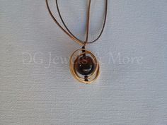 Planet Tweested Circles pendant gold plated brown cat eye adjust tinas creations #TinasCreations #Pendant Brown Cat, Gold Necklace, Pendant Necklace, Gold Pendant, Cat Eye, Circles, Planets, Pendants, Necklaces