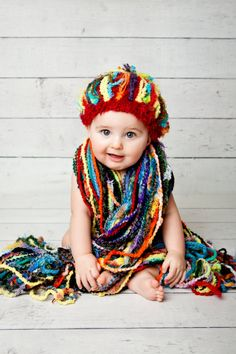 Cost is $45  This fringe only, all fringe, all the time, fringe galore, handtied scarf design features all GIANT, bulky, thick yarns for a crazed boho look that's child like and irreverent! Plus it's HUGE, raggedy and fun like doll hair!    Colorful pro photography with newborn and 6 month old by Sweet Pea Photos in West Jordan, Utah at www.sweetpeaphotos.com (thank you, Sheri!)    For this scarf as a SET with MATCHING HAT for 6 month old, as shown…