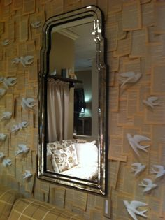 Bunny Williams for Mirror Image Venetian Mirror against pages of vintage book and doves. #hpmkt