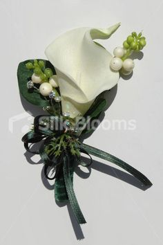 Ivory Calla Lily Bridesmaid Bouquet with Green Velvet Ribbon Ivory Calla Lily Bridesmaid Bouquet with Green Velvet Ribbon [Bethany - Bridesmaid] - £42.99 : Artificial Wedding Flowers | Bridal Bouquets | Silk Wedding Flowers | Wedding Bouquets | Wedding Flowers, Silk Blooms Glasgow, we sell and hire artificial wedding flowers, bridal bouquets, buttonholes and wedding table arrangements.