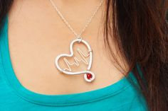 Heartbeat Inside Hammered Heart with One Red Crystal $28.00