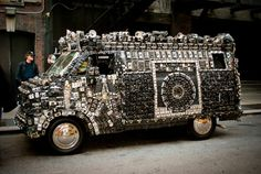 Harrod Blank envisioned a car covered in cameras that he could drive around and take pictures with. Two years, 2700 cameras later, the dream was a reality. http://cameravan.com/ http://www.impactlab.net